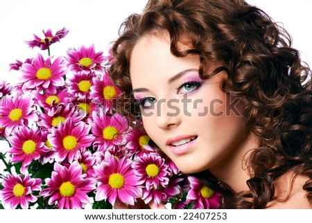 Close-up face of a young beautiful woman with flowers