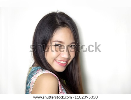close up face of asian lady smile with pink lipstick on studio shot. Confidence lady with cosmetic on face.Sexy asian lady portrait on white background.