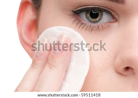 Close-up face of beauty young woman applying face foundation by sponge