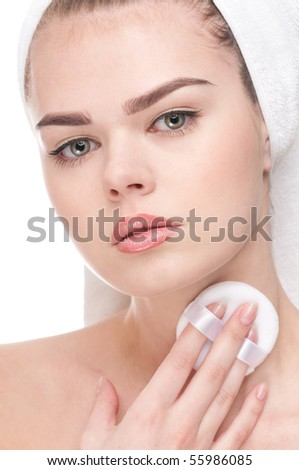 Close-up face of beauty young woman applying sponge - isolated on white