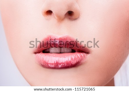 Close-up face of beauty young woman lips.
