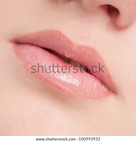 Close-up face of beauty young woman - lips make-up zone