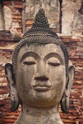 Close-up Face of Old Buddha in Wat Phra Si Rattana Mahathat Temple Ayutthaya , Thailand.