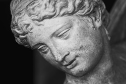 Close up face of Olympic goddess of love and beauty Aphrodite (Venus). Fragment of ancient statue.