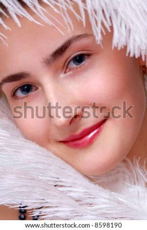 Close-up face of the girl with blue eyes and lovely smile.