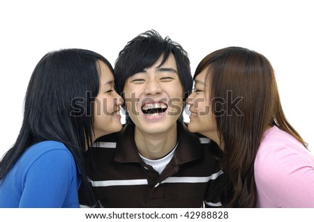 Close-up face of three beautiful teenagers laughing and having fun