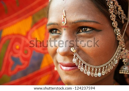 Close up face of Traditional Indian woman in sari costume, India