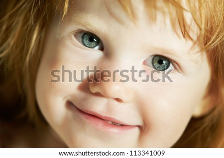 close-up face portrait of smiling little child