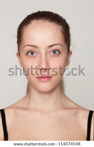 Close-up face portrait of young woman  without make-up. Natural image without retouching w/shallow depth of field.