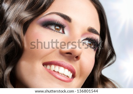 Close up face shot of beauty brunette smiling.