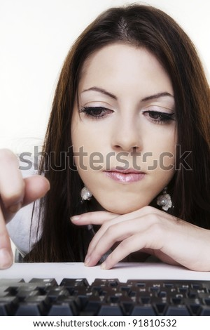 close up face shot of woman bored at work not really doing much