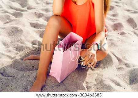 Close-up fashion details of woman celebrate her birthday on summer,relax after shopping holidays,shopping bag,summer accessories,gift certificate,rest after shopping,shopaholic,gift bag discount