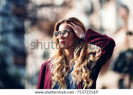 Close up fashion street stile portrait of pretty girl in fall casual outfit Beautiful blond posing outdoor. Girl wearing stylish burgundy coat and red lips - Shutterstock ID 753722569