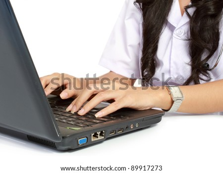 Close Up Female doctor working with laptop isolated over white background