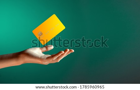Close up female hand holds levitating template mockup Bank credit card with online service isolated on green background Photo stock ©