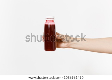 Close up female holds in hand dark red detox smoothies in bottle isolated on white background. Proper nutrition, vegetarian drink healthy lifestyle, dieting concept. Advertising area for copy space