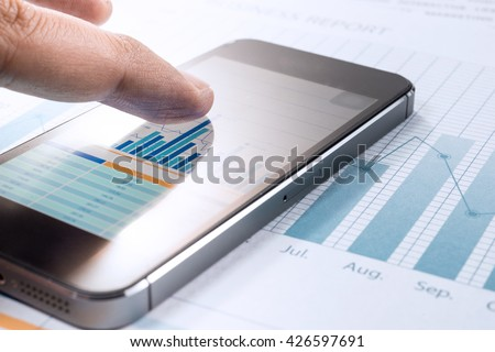 Close up finger hand of businessman touching smartphone and graph chart  background.For business market  concept