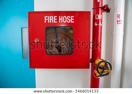 Close up Fire Hose reel equipment in building  #1466014133