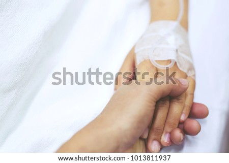 close up focus on the Shake hands of a patient sick encourage encouragement on the bed in hospital ward.