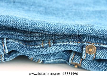 Close up folded blue jeans