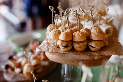 Close-up food for party: snacks, burgers, canapes. Catering service.
