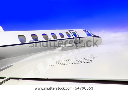 Close-up, forward view of a private jet plane.
