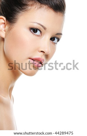 Close-up fresh face of a beauty asian woman isolated on white
