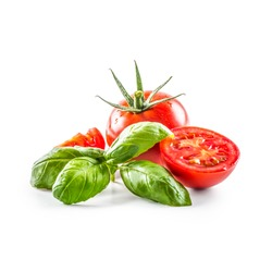 Close-up fresh tomato with basil isolated on fhite background.