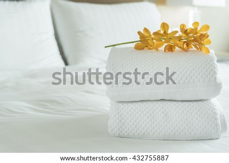 Close up, Fresh white Towel with flowers placed on the inside of the hotel room.