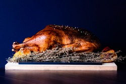 Close up from a roasted goose with blurred background and decoration