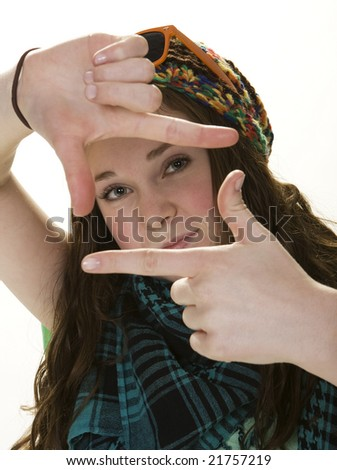 Close-up front view of female teenager making hand gesture.