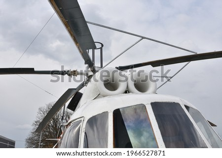Close up front view on main rotor blades, rotor mast and part of cockpit windows of the Russian white twin-engine multipurpose helicopter Mi-8.  ストックフォト ©