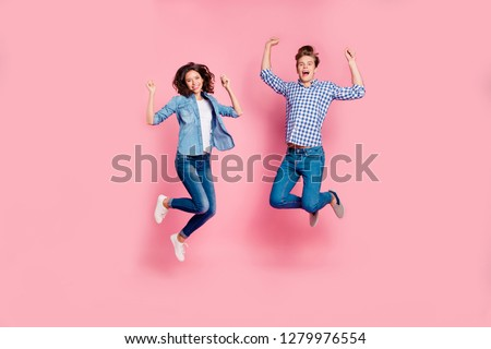Close up full length body size photo of jumping high she her he him his lady guy hands above head having best day time weekend wearing casual jeans denim plaid shirts isolated on rose pink background