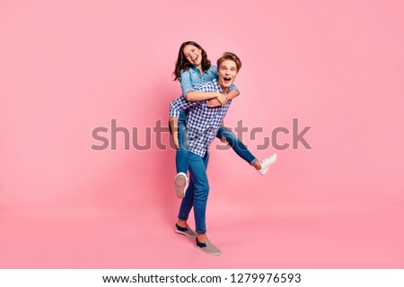 Close up full length body size photo of piggy back hugging she her he him his lady guy boy going to competitions best team wearing casual jeans denim plaid shirts isolated on rose background