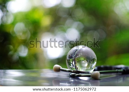 close up glass global and stethoscope on table, green nature copy space background for text, world health day, medical and healthcare business technology concept #1175062972