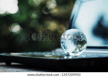 close up glass globe on computer, nature copy space background for text, shopping online business technology, global data network, saving and manage money fo future, vintage tone