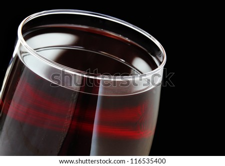 Close Up Glass of Red Wine isolated on a black background