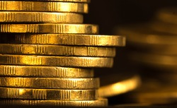 Close up gold money coin stacking on dark background