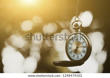 close up gold pocket watch and nature bokeh copy space background for text, saving and manage time to success business, countdown to holiday season, happy new year 2019 concept #1248474502