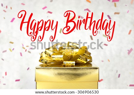 Close up Golden present box with Happy Birthday word and confetti blur background.