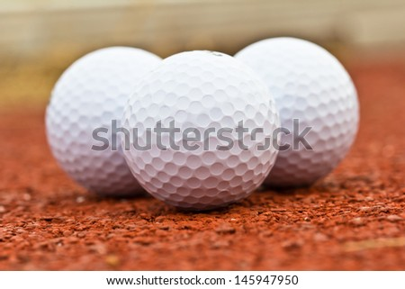 Close up golf ball on the ground.
