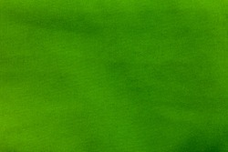 close up green fabric texture. top view