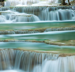 Close up green forest waterfall Huay Mae Kamin National Park Kanjanaburi Thailand