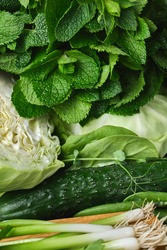 Close up Green vegetables, dark leafy food background. Healthy eating concept of fresh garden produce organically grown.