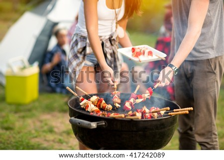 Close up grill with colorful barbecue on grill in campground