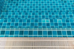 Close up Grille drain of sewer around the swimming pool. Water recirculation system. Wastewater treatment.