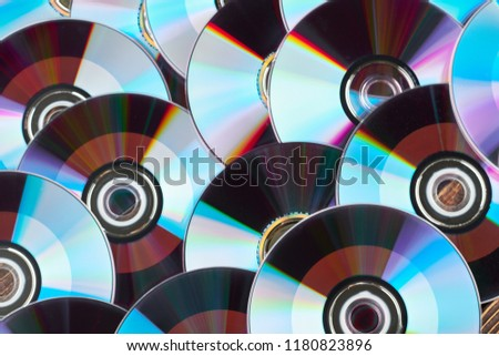 Close up group of DVD discs. Colorful compact disks background. Shiny CD disks as wallpaper.