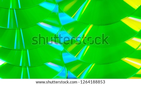Close up group of green and yellow DVD discs. Background from colorful compact disks. #1264188853