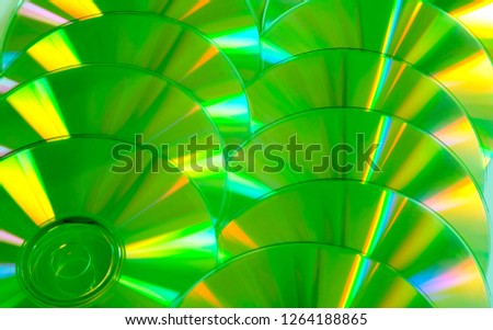 Close up group of green and yellow DVD discs. Background from colorful compact disks. #1264188865