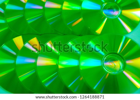 Close up group of green and yellow DVD discs. Background from colorful compact disks. #1264188871
